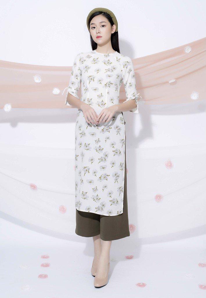 Áo dài cưới cách tân rất vừa toát lên vẻ đẹp dịu dàng, vừa tiện hoạt động cho các nàng dâu trong ngày cưới